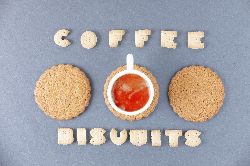 Coffee and biscuits words written with biscuit shaped letters
