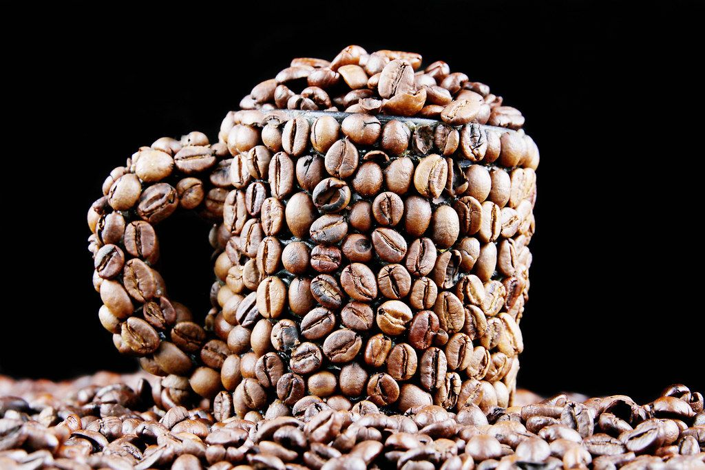 Coffee beans in a cup, black background (Flip 2019)