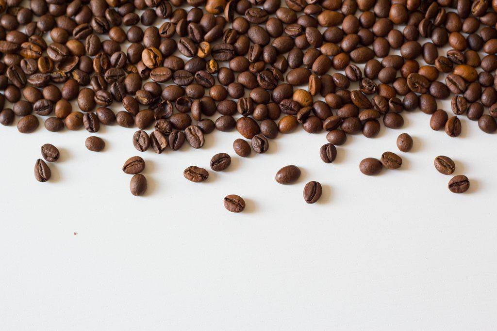 Coffee beans on white table