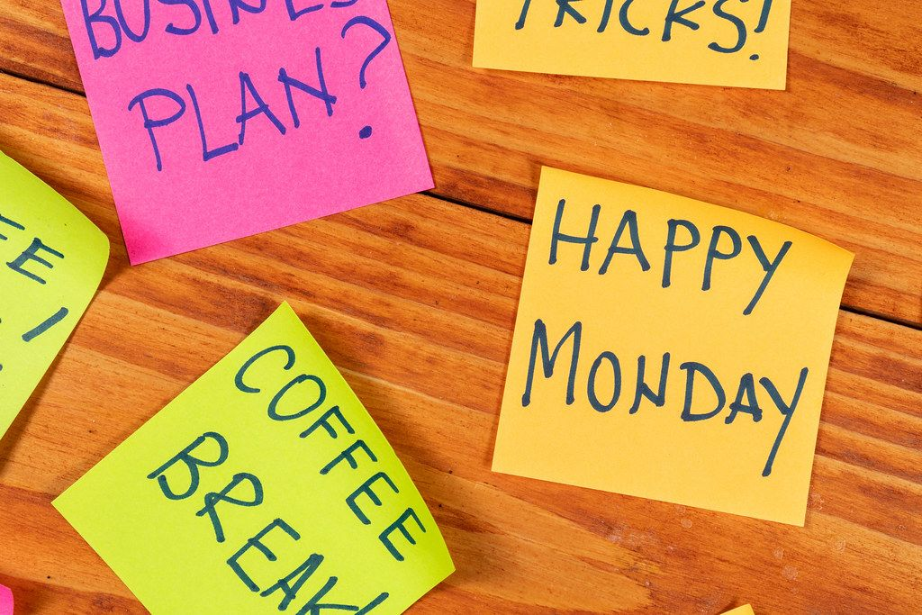Coffee Break and Happy Monday sign on the reminder papers