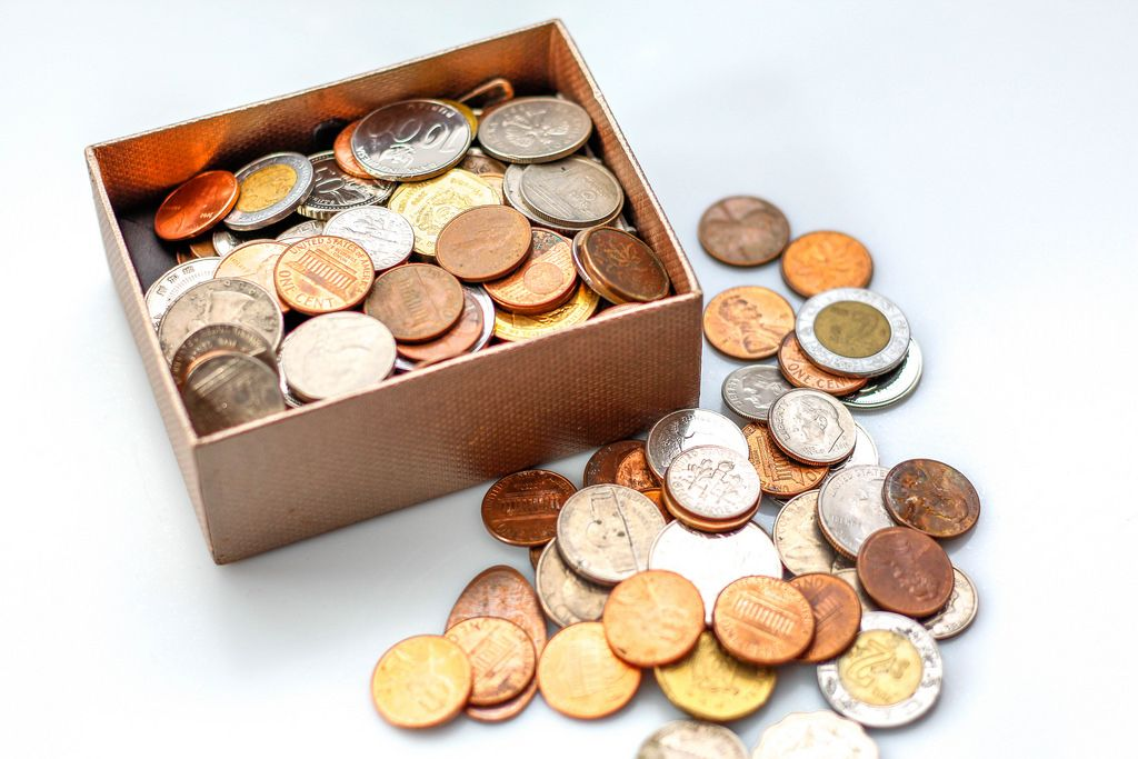 Coin in a box on a White Background
