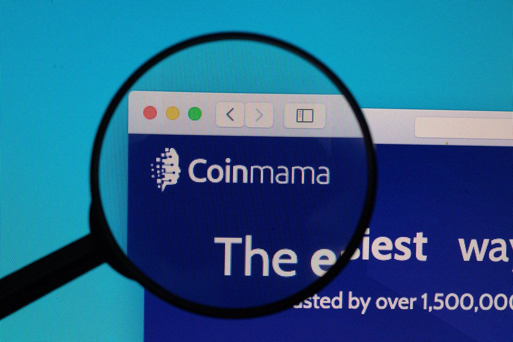 Coinmama logo under magnifying glass