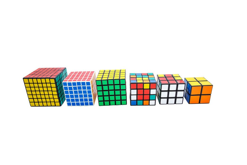 Collection of different Rubik's cubes on white background  (Flip 2019)