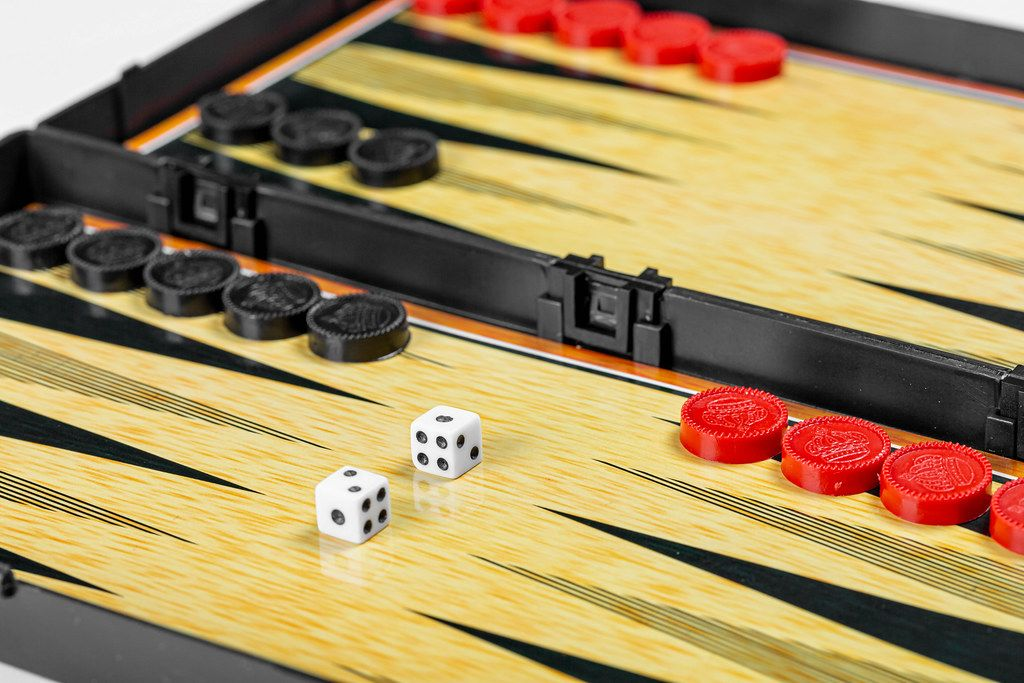 Color detail of a Backgammon game with two dice (Flip 2019)