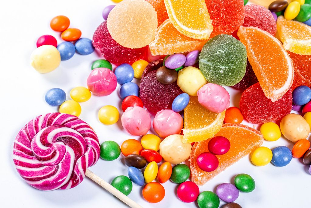 Colorful candies, jelly and marmalade on white background. Top view