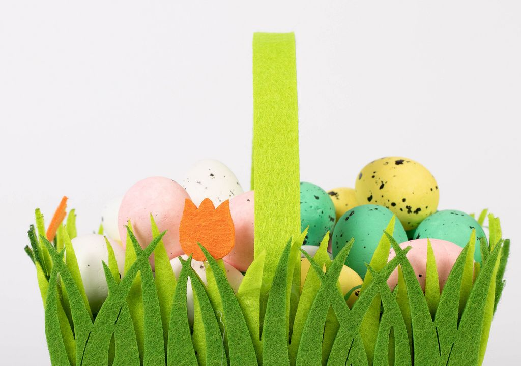 Colorful handmade Easter eggs in the basket