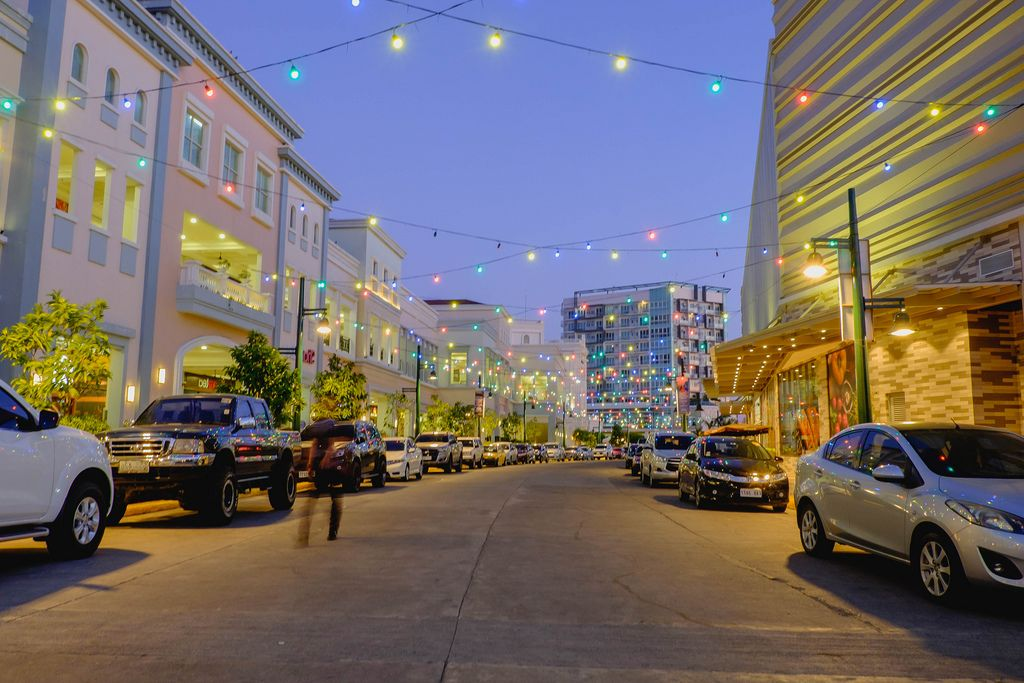 Colorful hanging lights shining across the street (Flip 2019)