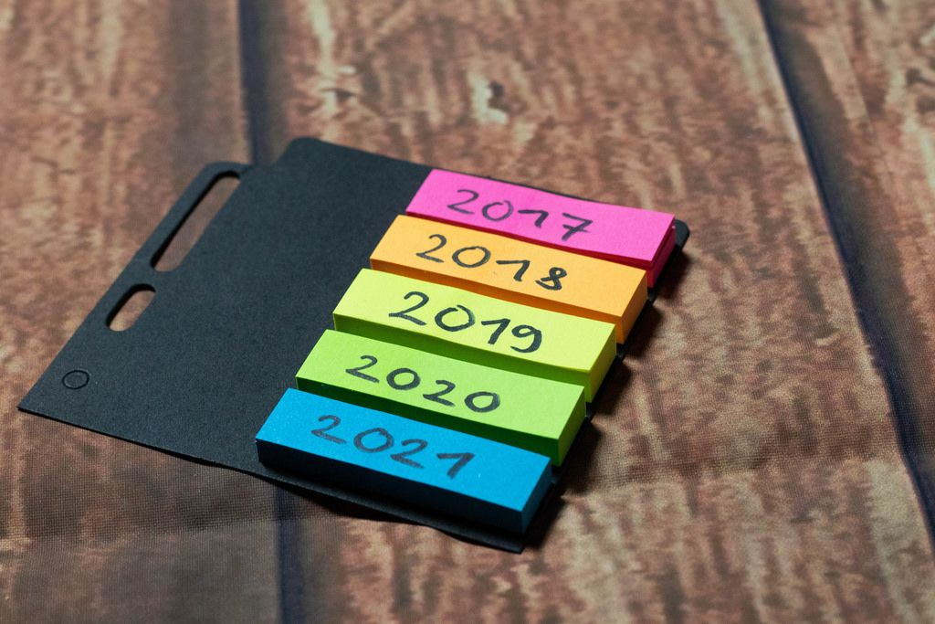 Colorful notes with years written on
