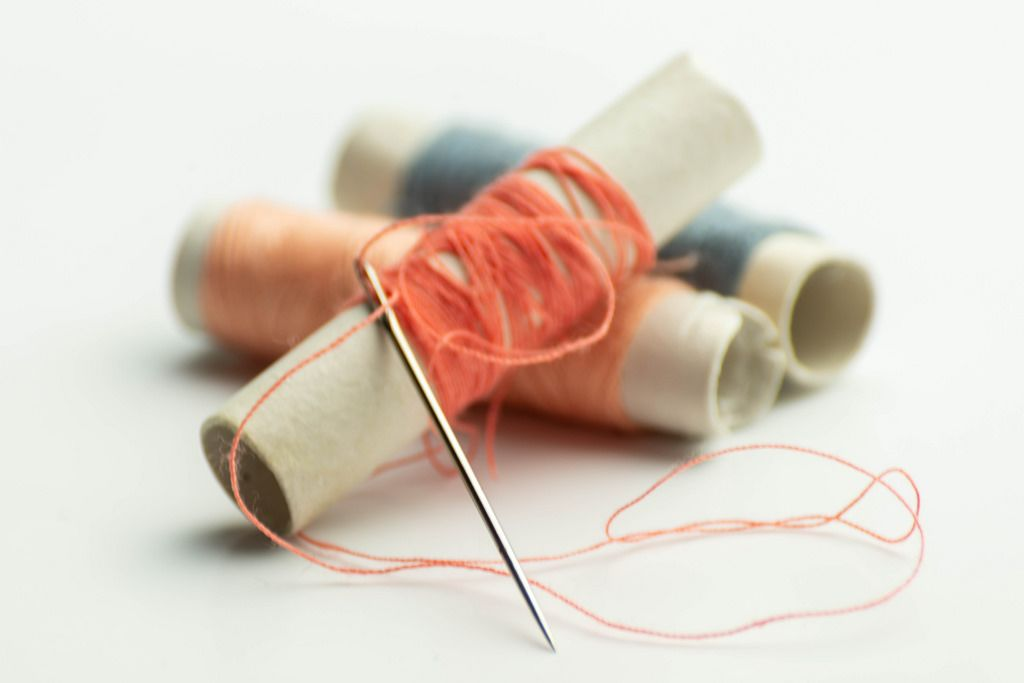 Colorful threads on spools with a needle