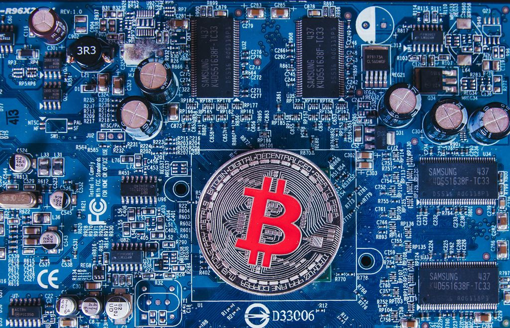 Computer mother board with silver Bitcoin
