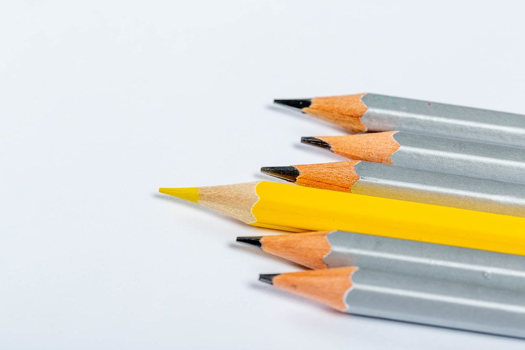 Concept leadership, think different, business success. All gray pencils, and one yellow on white background