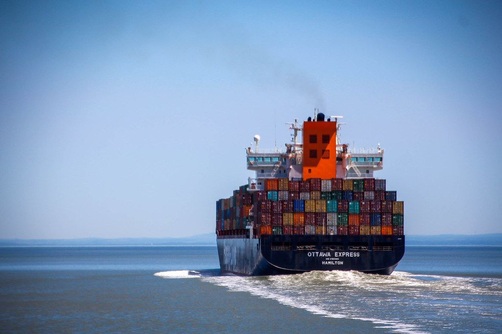 Container Ship at Sea with Clear Sky