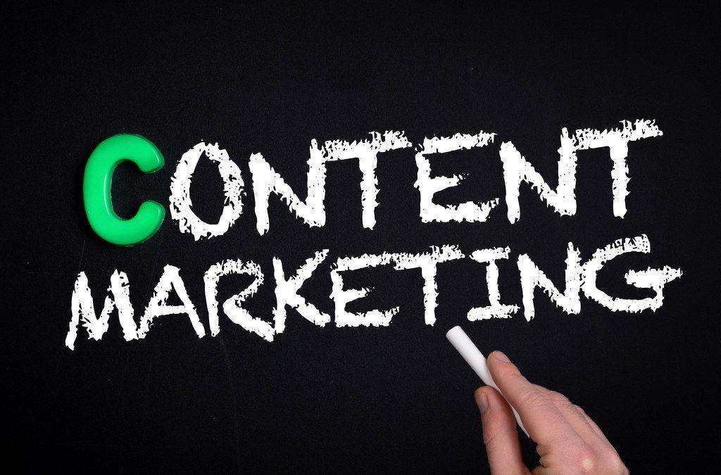 Content marketing text on blackboard