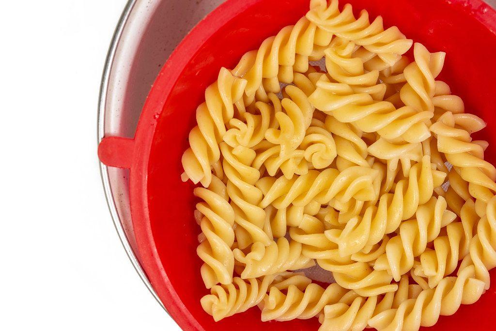 Cooked Pasta in the plastic colander