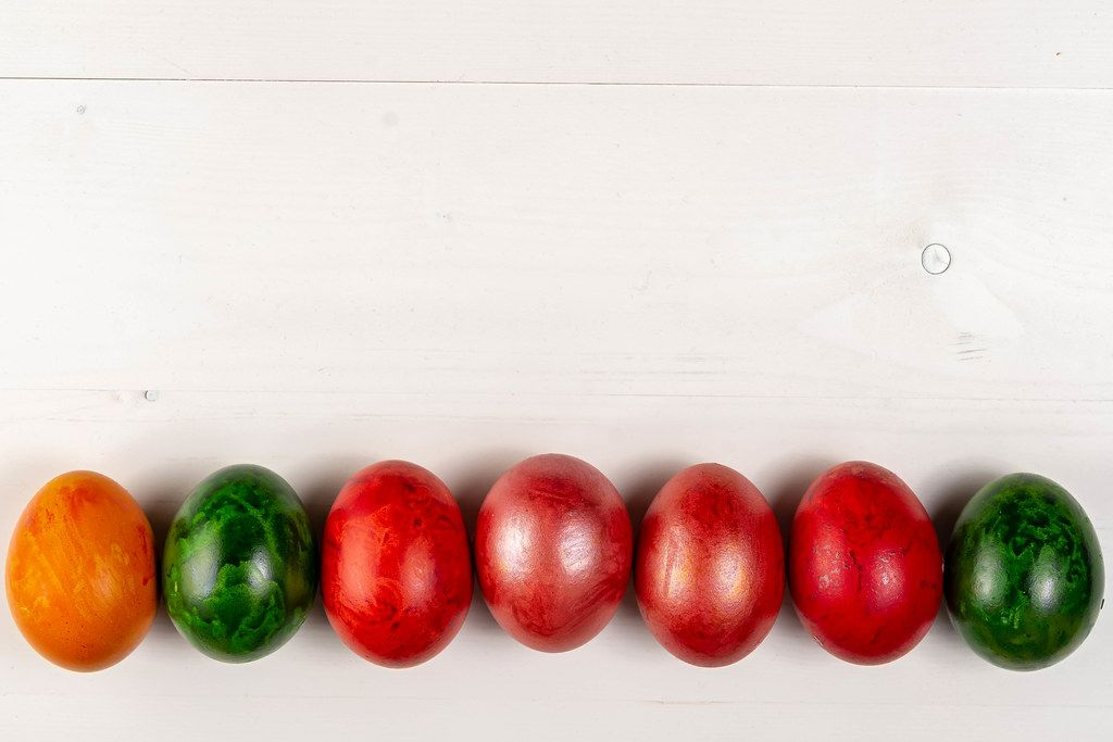 Copy space above wooden background and Colored Easter Eggs (Flip 2019)