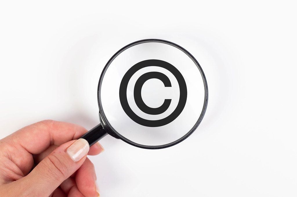 Copyright symbol under magnifying glass
