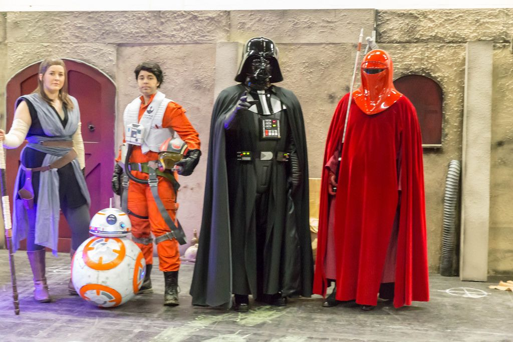 Cosplayers dressed as Darth Vader and other Star Wars characters