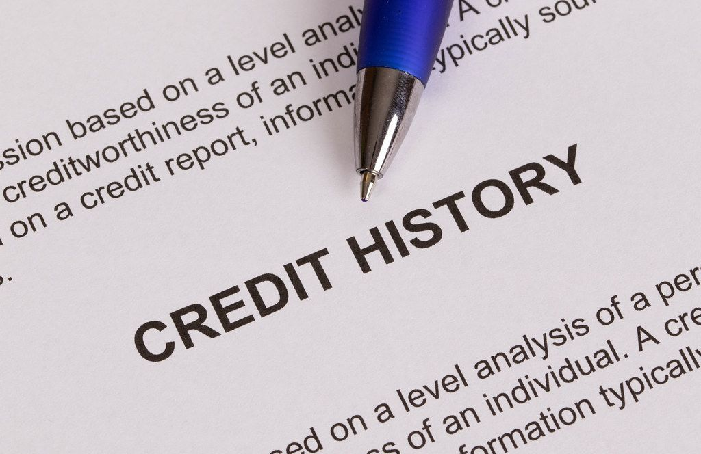 Credit history document with pencil