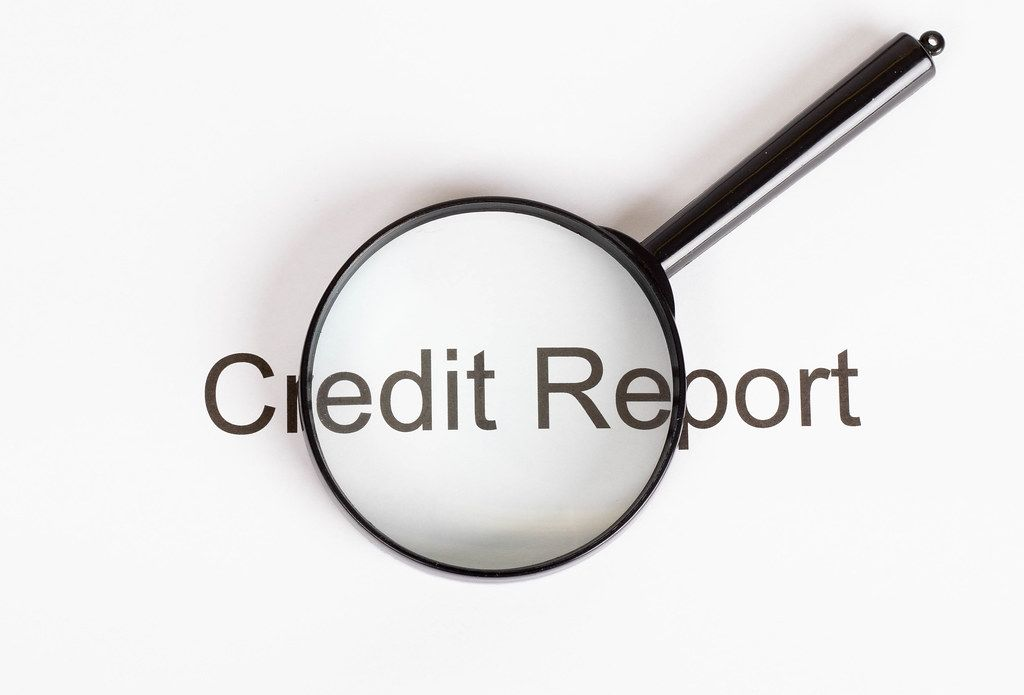 Credit Report text under magnifying glass