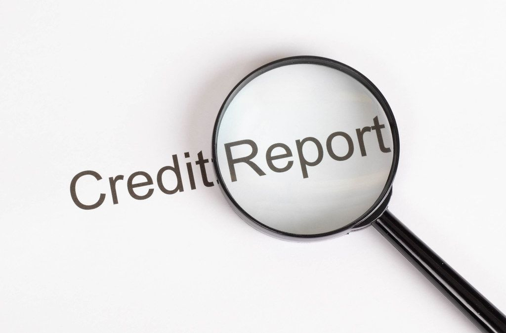 Credit Report text with magnifying glass