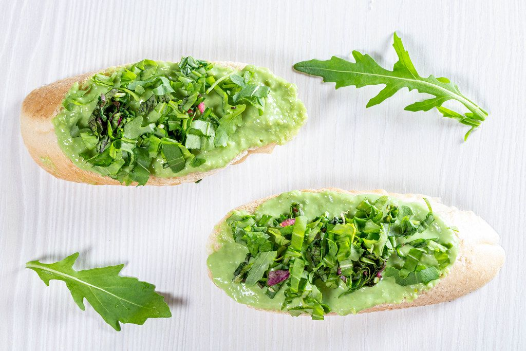 Croutons with avocado guacamole with arugula leaves (Flip 2019)