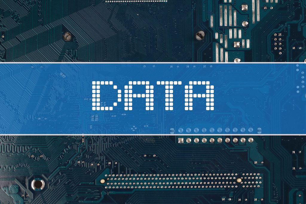 Data text over electronic circuit board background
