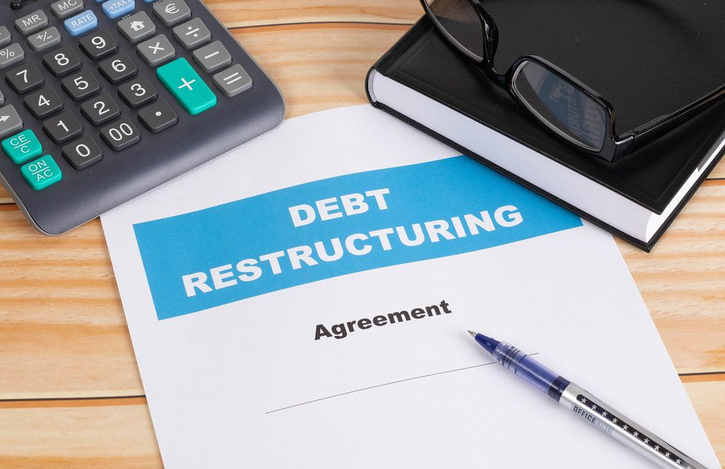 Debt Restructuring Agreement with calculator on table