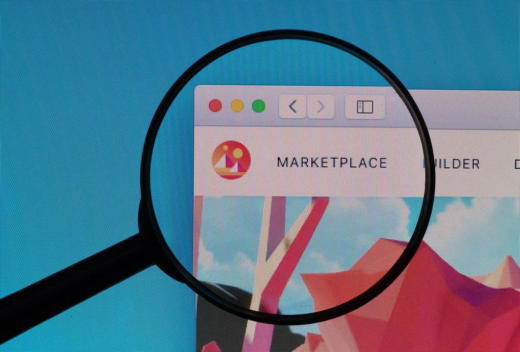 Decentraland Marketplace logo under magnifying glass