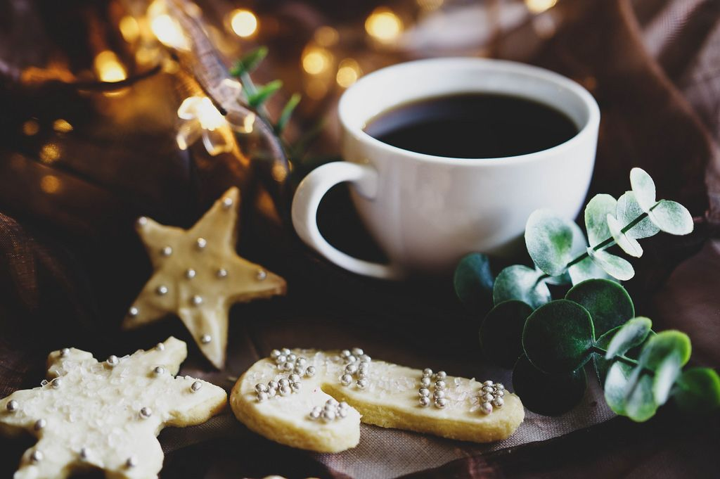 Decorated sugar cookies with a cup of coffee