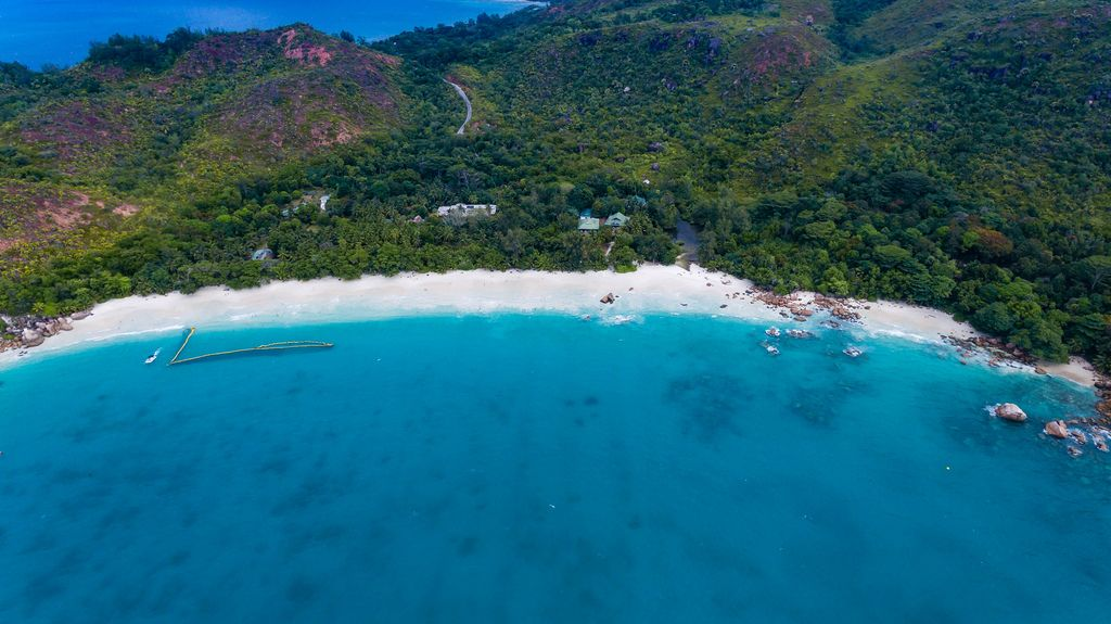 Deep blue water and an amazing beach in Grand'Anse Praslin, Seychelles - aerial photography