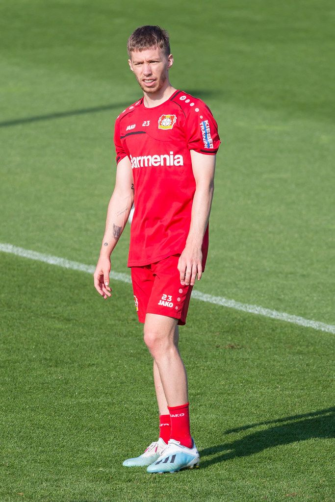Defender Mitchell Weiser stands alone on the grass during football training