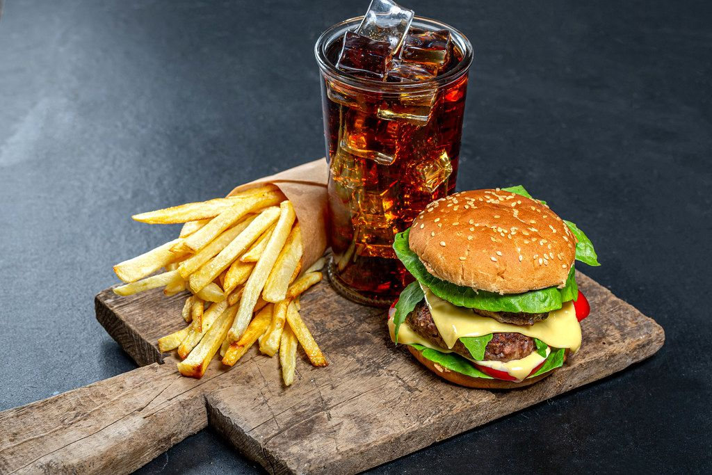 Delicious junk food-Burger, iced drink and fries