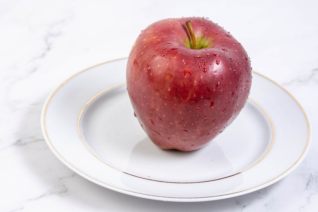 Delicious red Apple on the plate