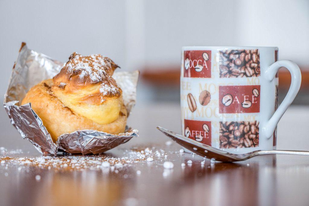 Delicious self-made pastel de nata and coffee