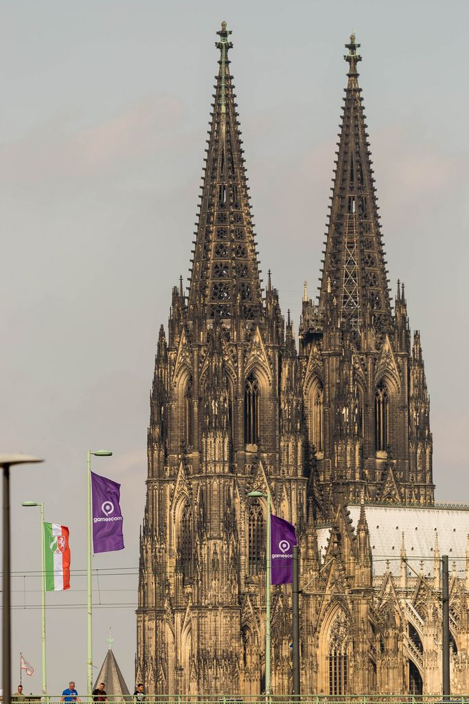 Deutz Suspension Bridge with Gamescom flags and Cologne Cathedral in the background