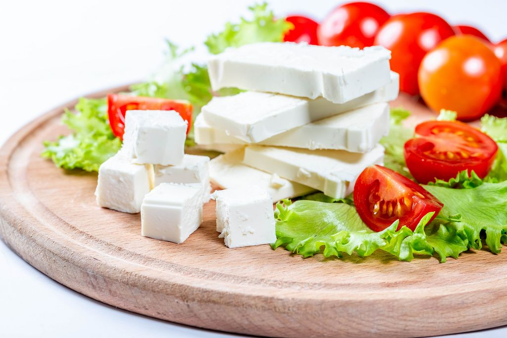 Diced feta cheese with tomatoes and lettuce