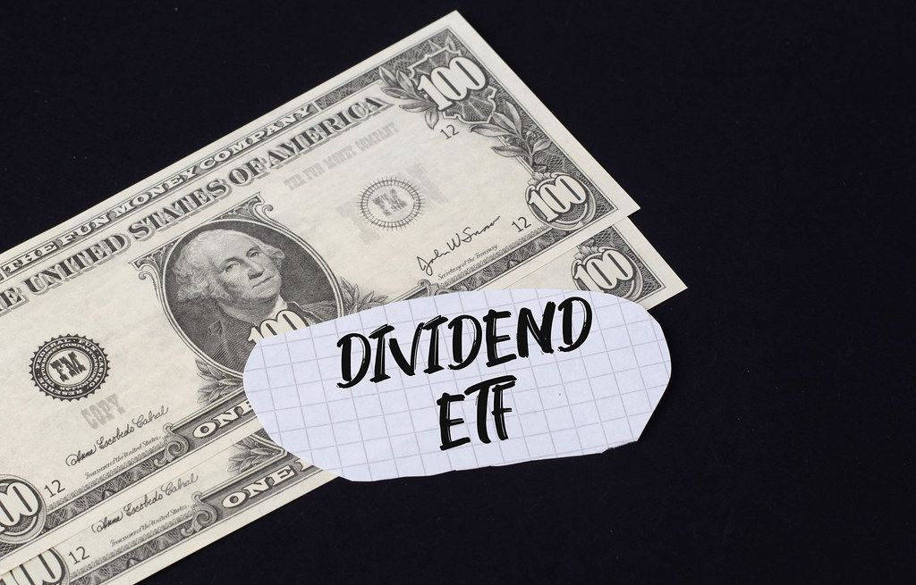 Dividend ETF text and dollar banknotes