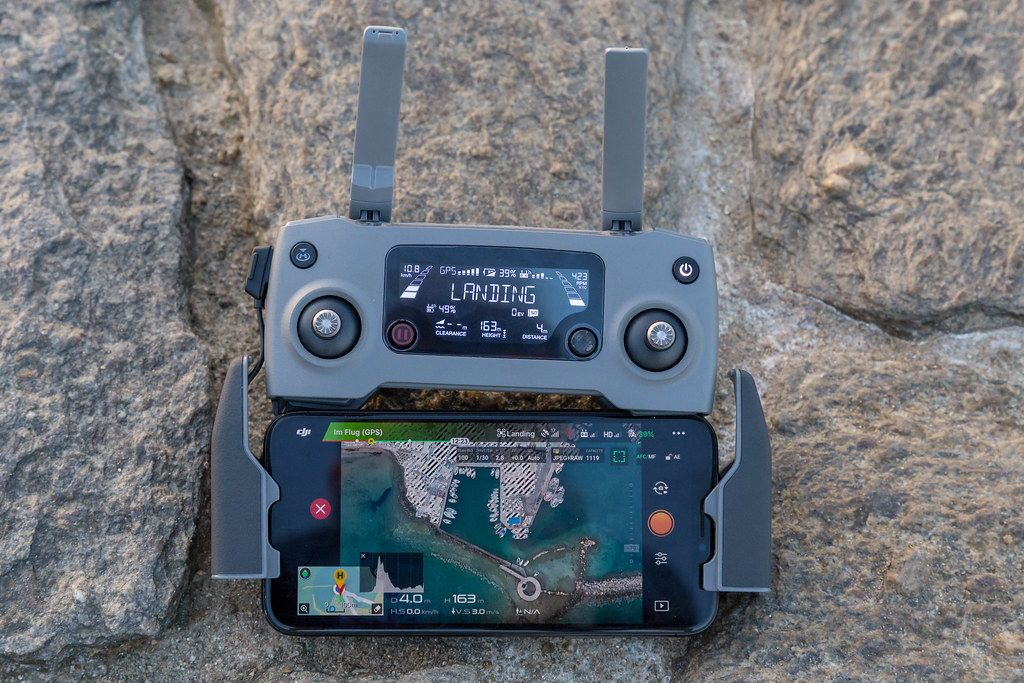 DJI Mavic 2 Controller with smartphone to watch the drone flight over Paros Island in Greece