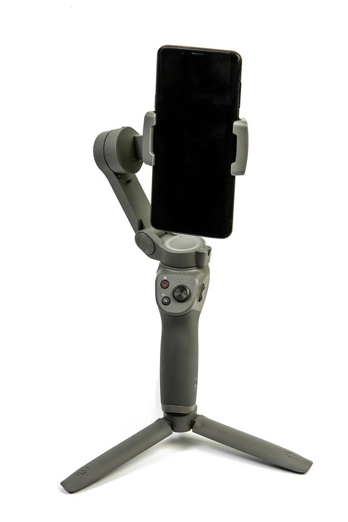 DJI Osmo Mobile 3 phone gimbal with mobile phone attached above white background (Flip 2019)
