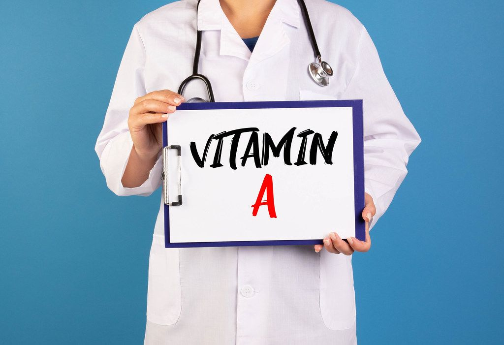 Doctor holding clipboard with Vitamin A text