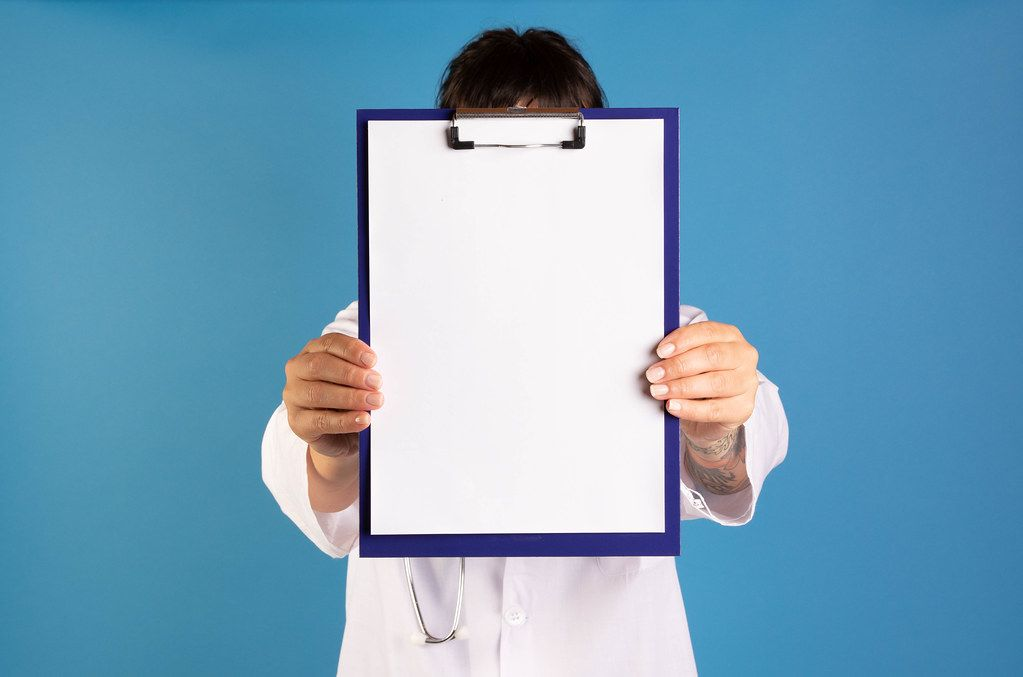 Doctor showing blank clipboard on blue background