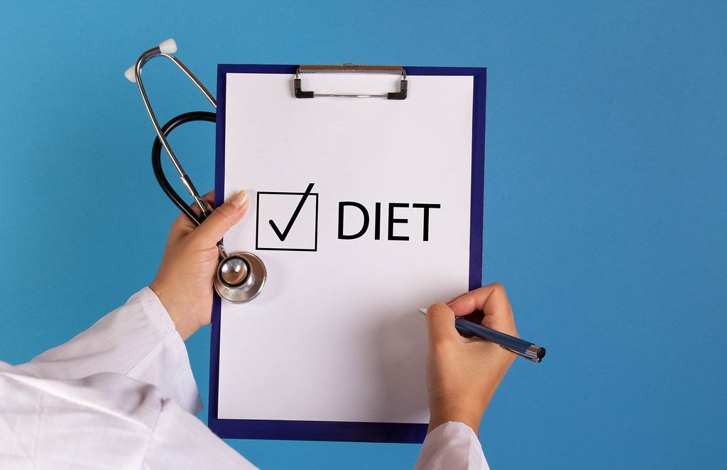 Doctor with prescription start with diet