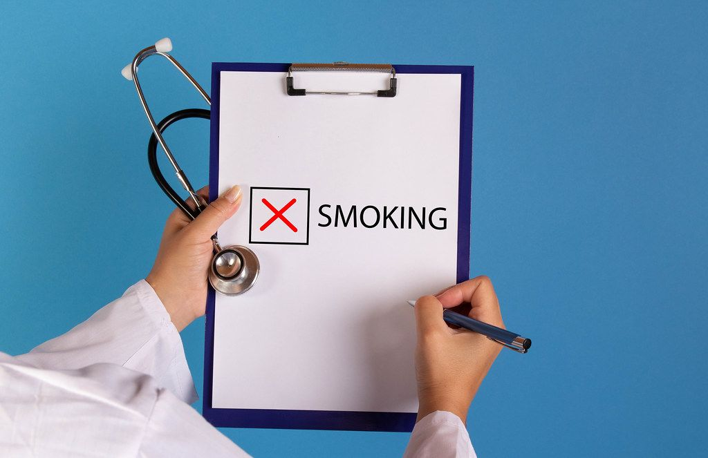 Doctor with prescription stop smoking