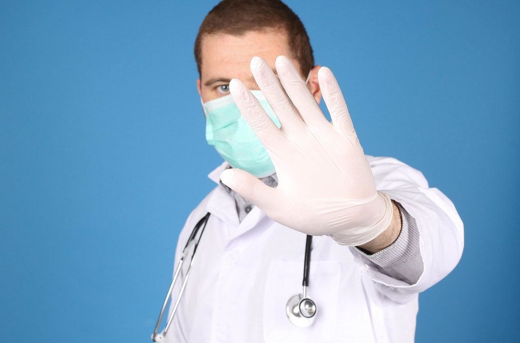Doctor with stethoscope showing stop gesture