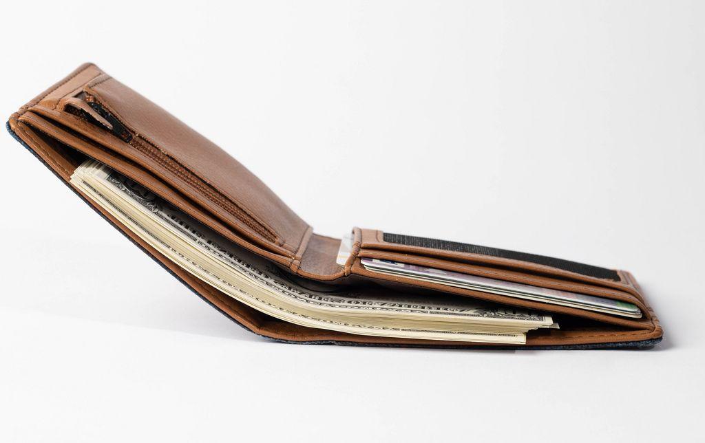 Dollar bills in brown leather wallet (Flip 2019) (Flip 2019) Flip 2019