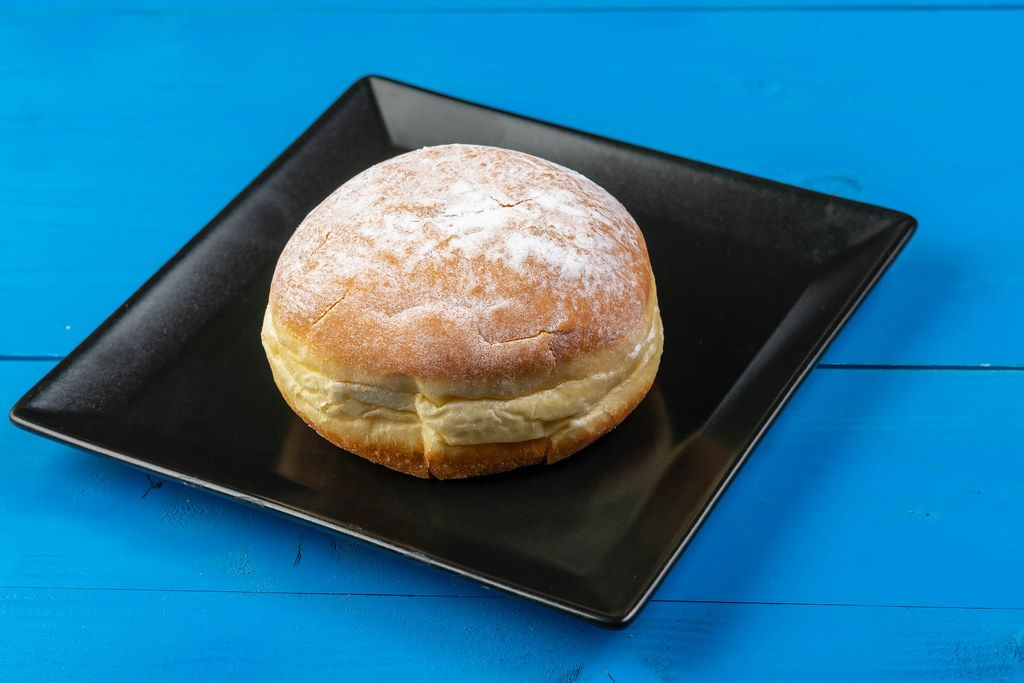 Donut with Powdered Sugar on the black square plate (Flip 2019)