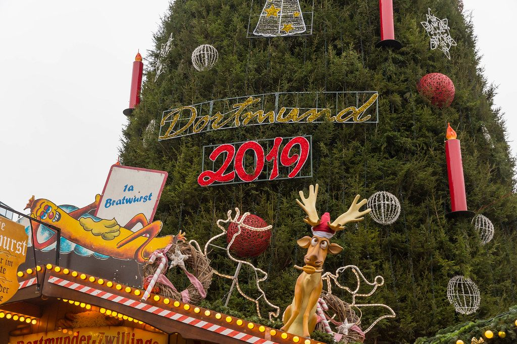 Dortmund celebrates christmas time 2019 with a hugh christmas tree with big baubles and xxl-candles on a German advent market