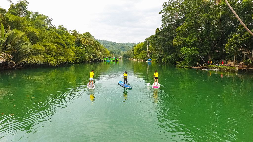 Drone shot of people kayaking in a river in Palawan Island