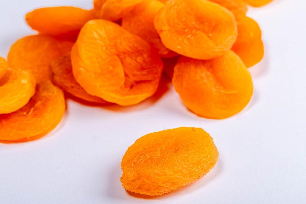 Dry apricots fruit on white background close up (Flip 2019)