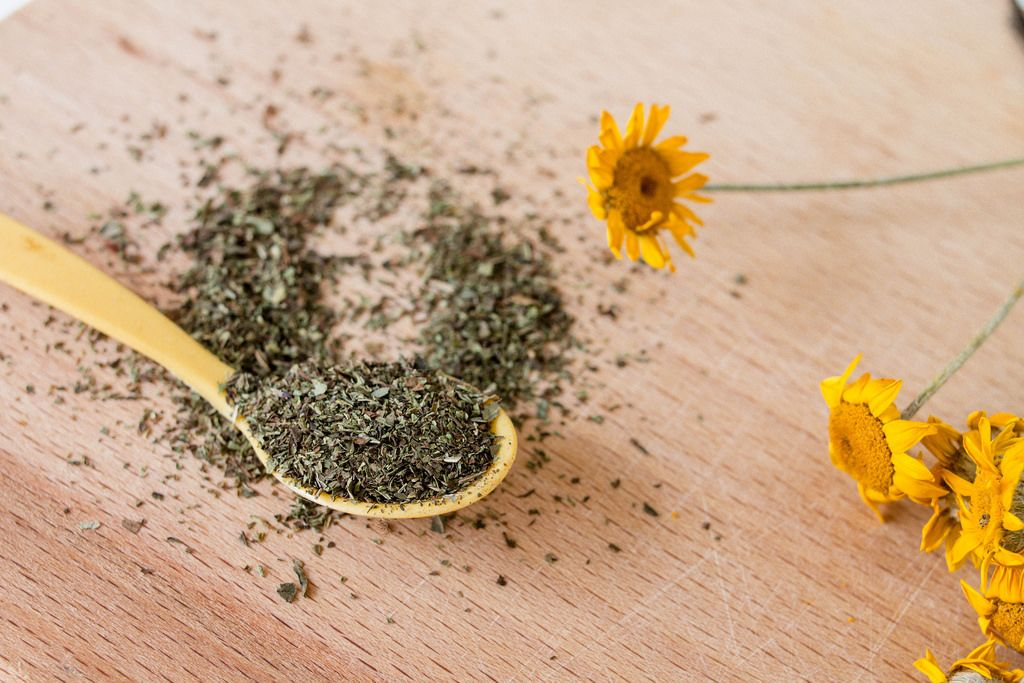 Dry oregano spice on wooden spoon